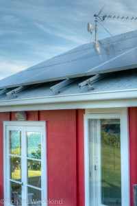 Red Cottage with solar panels.